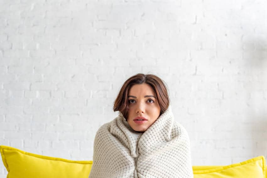 Cold Young Women Wrapped In Blanket-No Unit